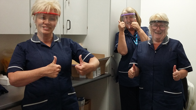 Clinicians wearing the visors designed and produced by Worksop College during the coronavirus outbreak